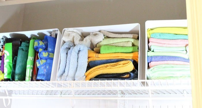 Arranging an assortment of dust free cloths.