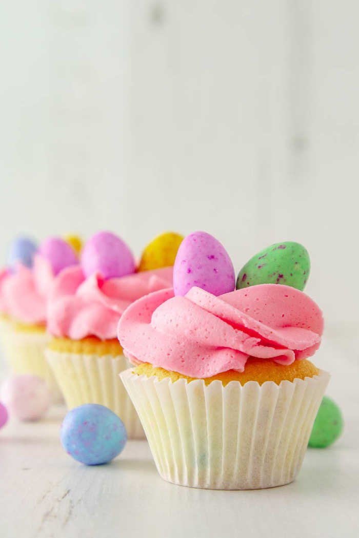 Pink buttercream icing cupcakes with Marshmallow Easter eggs
