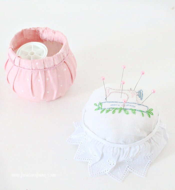 A feminine pin cushion or sewing kit with embroidery.