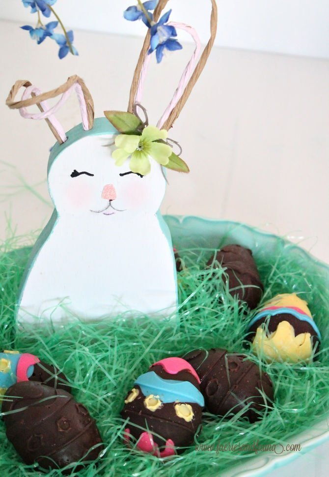 Displaying homemade chocolate Easter eggs with a bunny to create a Bunny garden.
