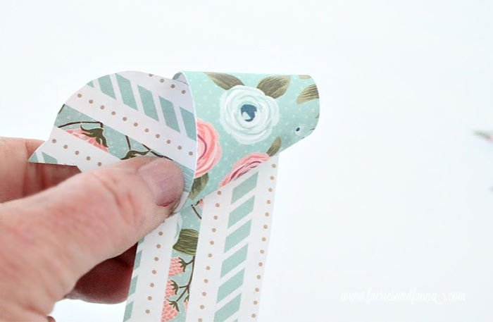 Folding paper into pretty origami bird for Spring. An easy origami craft.