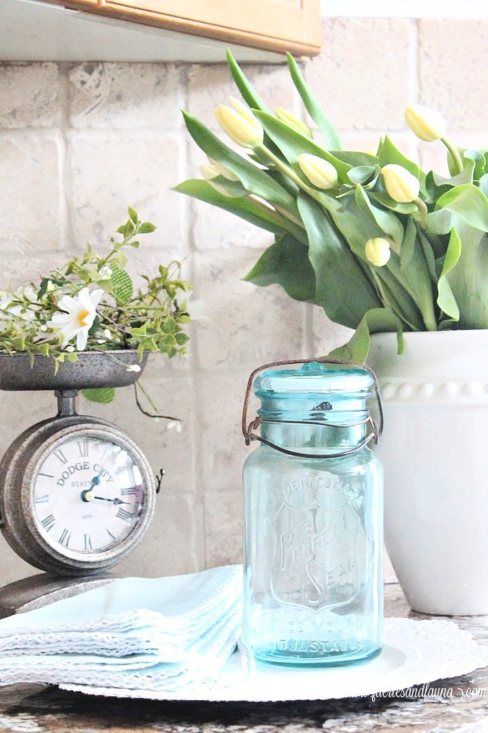 A antique turquoise blue mason jar, upcycled into a night light for the kitchen.