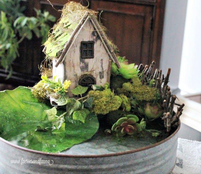 Adding greenery to finish a DIY fairy pond centerpiece or fairy garden