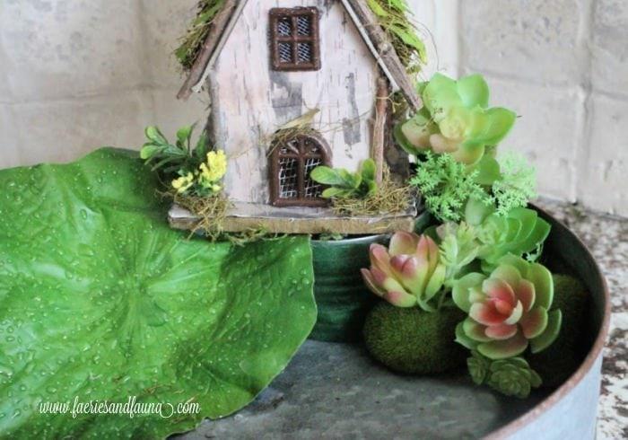 Placing a fairy hut onto a balcony for a fairy pond craft