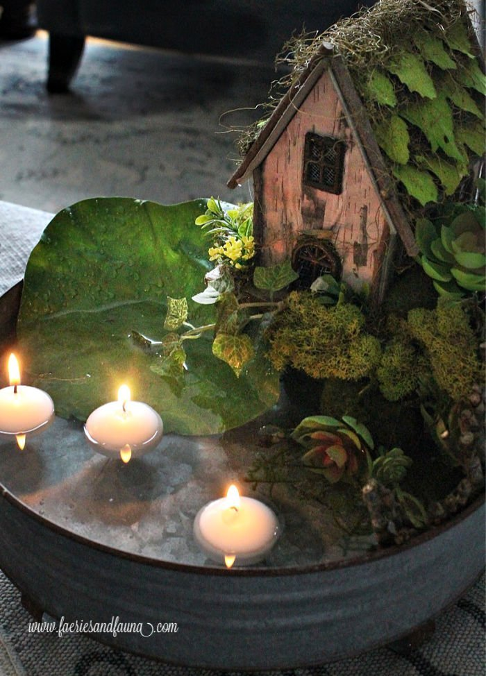 A DIY fairy pond with succulents and floating candles.