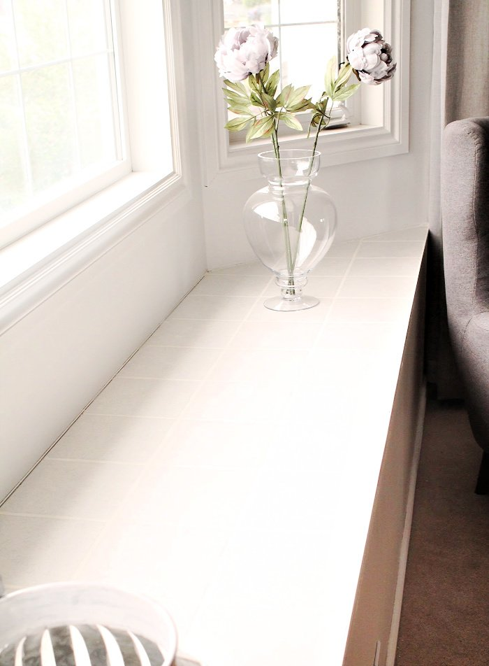 DIY tile tutorial using white tiles to protect a window alcove from pet damage