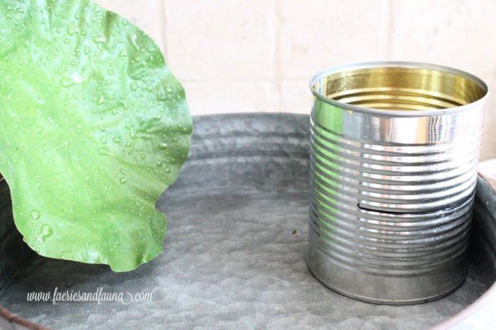 Using a tin can to make a balcony for a DIY fairy pond.