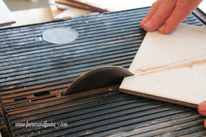 How to cut tiles with a wet tile cutter.