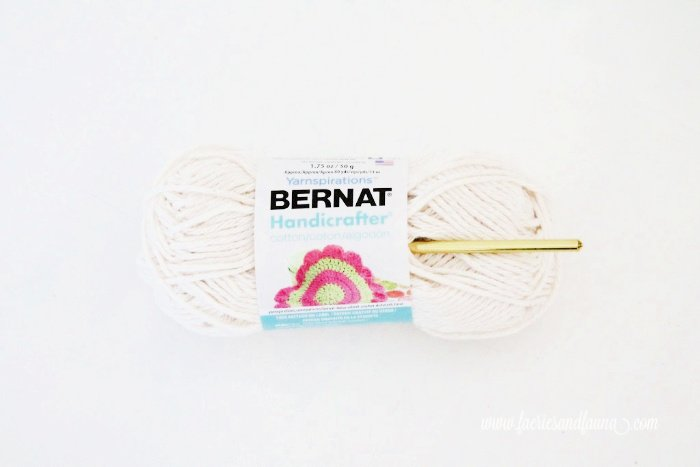 Cotton yarn for making a DIY flower pot with crocheted collar.