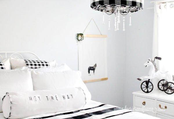 A farmhouse styled bedroom featuring handmade minimalist farmhouse art