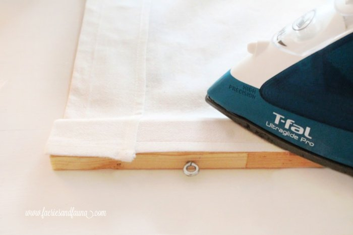 Ironing a towel to wood using stitch fix.