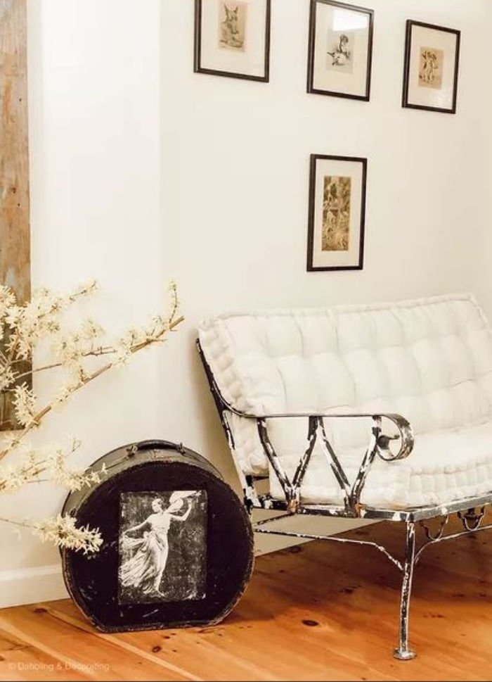 Black and white home decor with a DIY wrought iron chair makeover and black vintage suitcase.