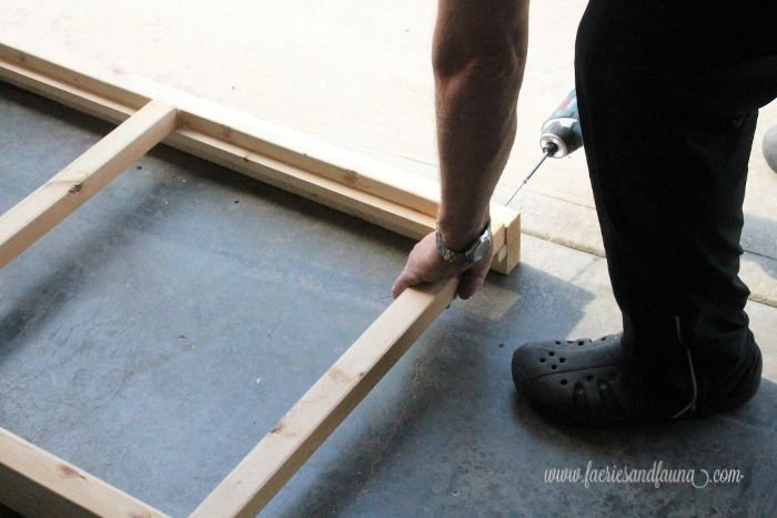 Drilling and screwing the pieces of a large pet ramp for outdoors.