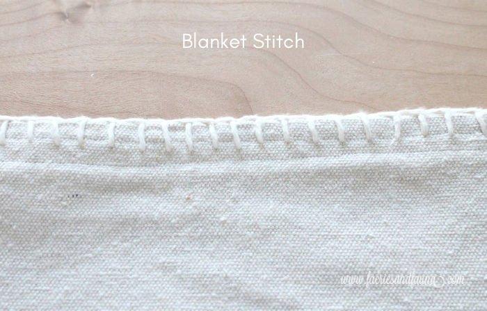 Blanket Stitch edging on DIY throw using dropcloth.