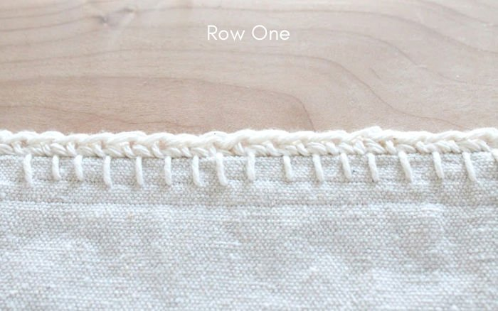 Single crochet stitches on a farmhouse DIY throw made with dropcloth