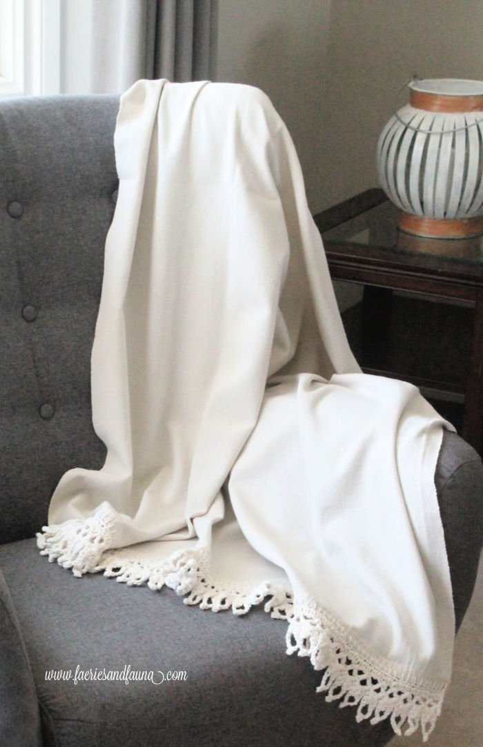 A dropcloth project. How to use dropcloth to make a couch throw.