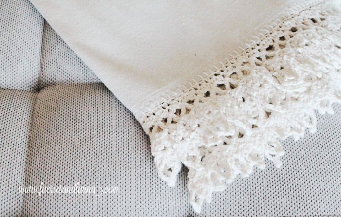Crocheted lace on a dropcloth throw