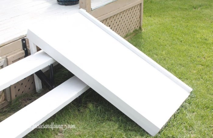 A outside dog ramp that fits over stairs.