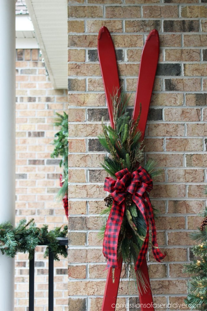 Decorating a Christmas front porch using thrift store skis