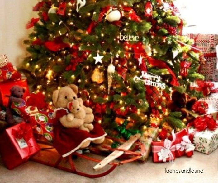 Using vintage sleigh underneath a Christmas tree