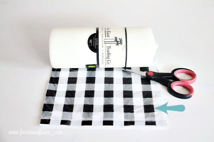 Tissue paper printed with buffalo check pattern for a DIY candle.