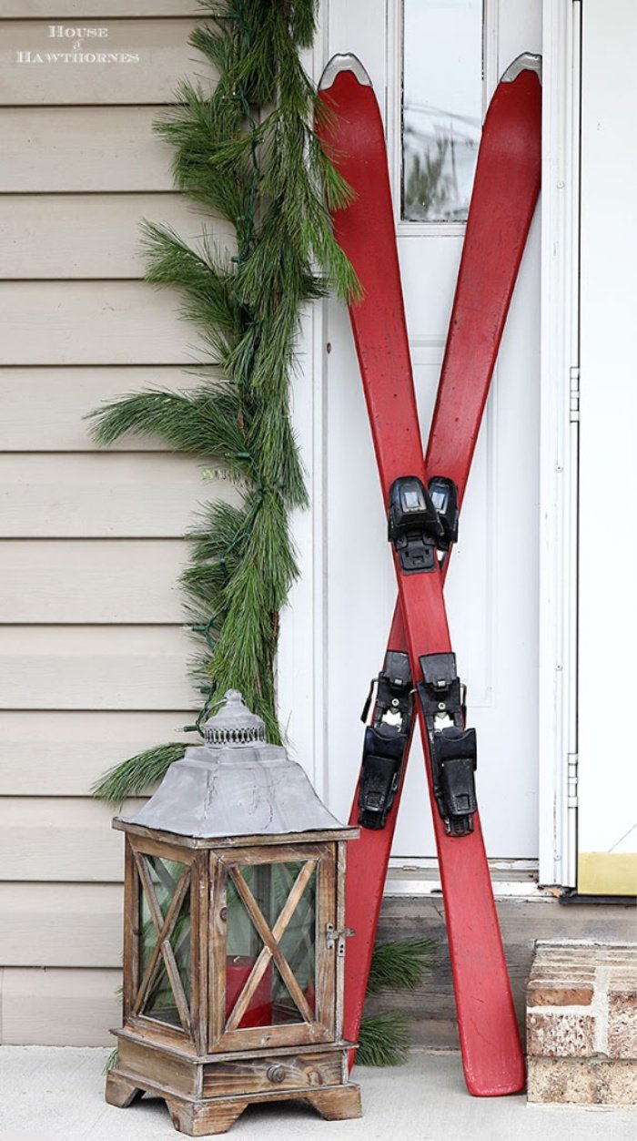 Christmas front porch decorated with skiis
