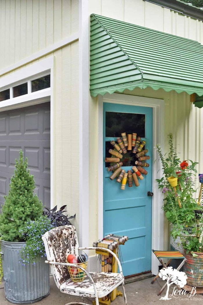 A DIY wreath idea using recycled croquet mallets