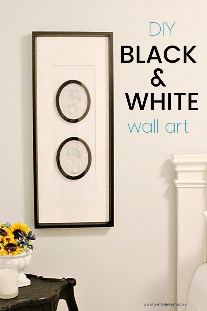 A large piece of black white artwork with paited black cameos in a frame with all white background, and black frame.