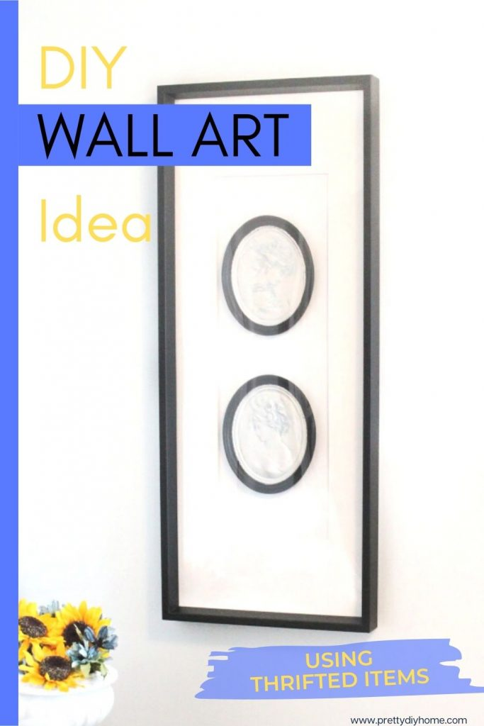 Large black and white wall art idea using two black and white painted cameos and a large IKEAframe