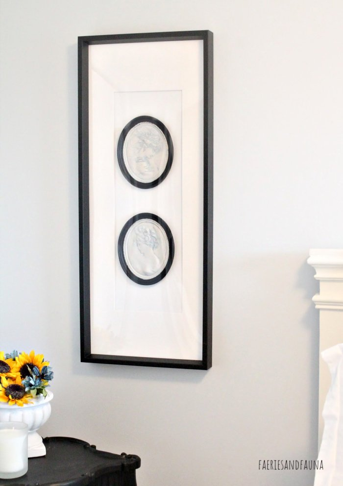 Using a large frame to group small items together for DIY Wall Art