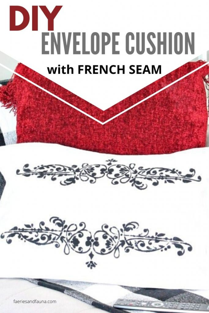 White Drop cloth and black stenciling create a dramatic french seamed cushion using drop cloth.