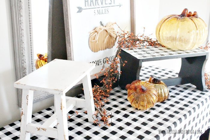 A Fall vignette display with two different type of decor stands.