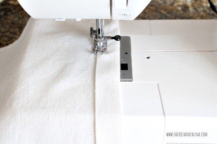 Sewing a one inch hem on a DIY cushion cover.