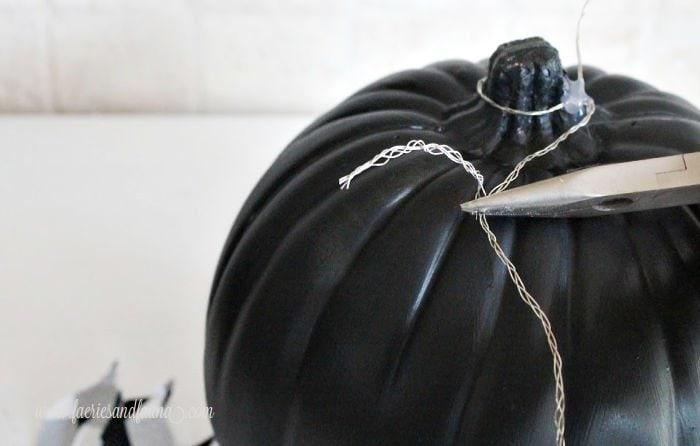 Building a wire leaf framework onto a Fall craft pumpkin.