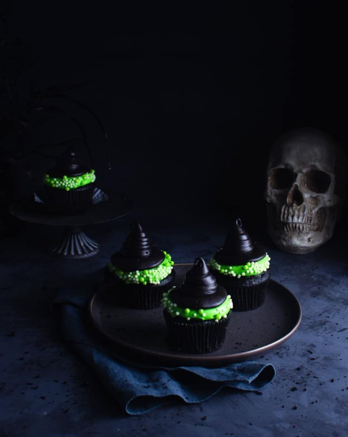 Dramatic and beautiful black and neon green witch hat cupcakes
