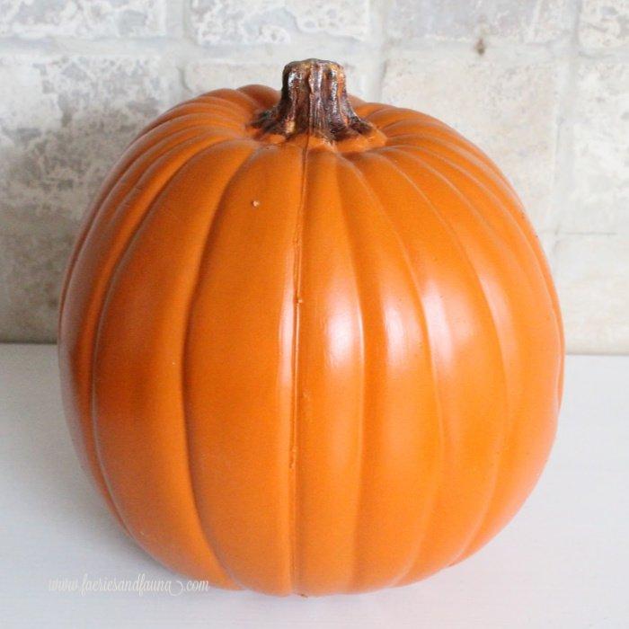 A plain plastic pumpkin for Fall decor craft