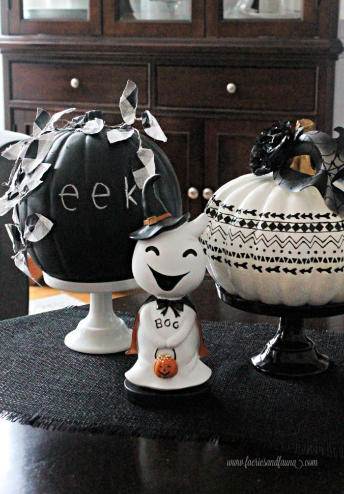 A not too scary Halloween decor using a DIY chalkboard pumpkin with buffalo check leaves.
