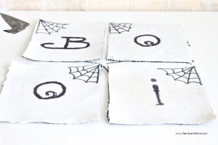 Halloween banner pieces that say BOO!