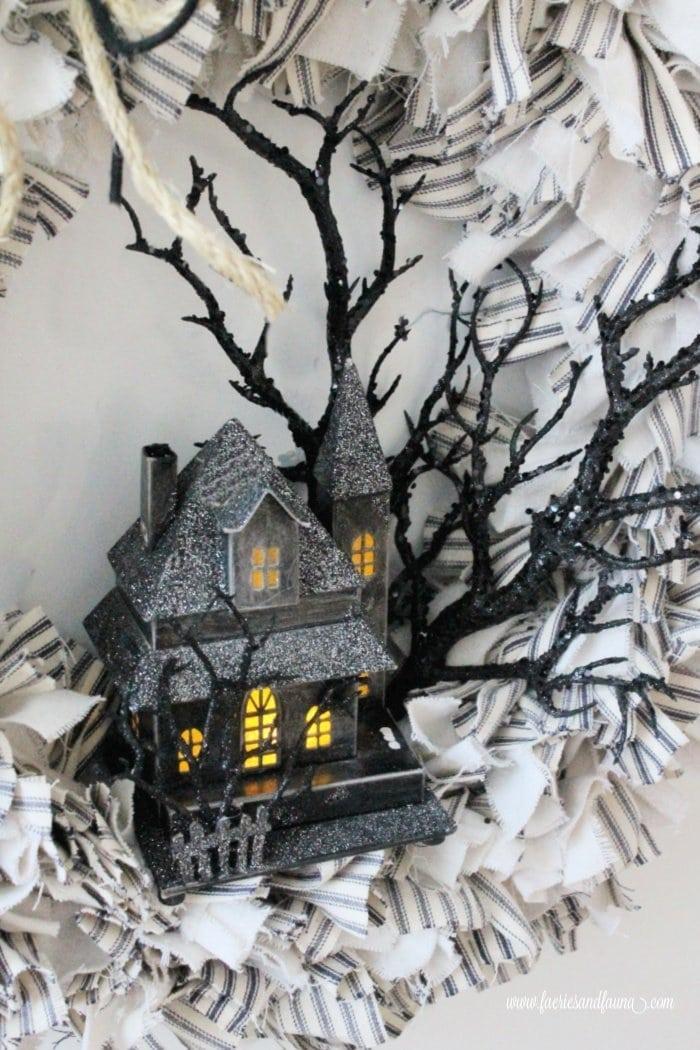 A DIY Halloween wreath made using ticking and dropcloth.