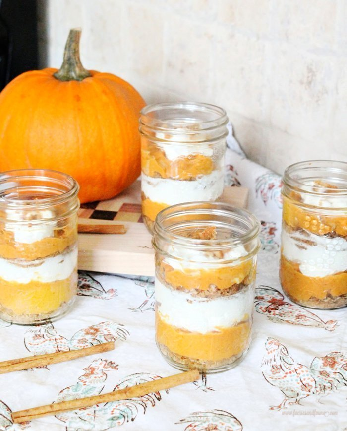 Large pint sized serving of layered pumpkin trifle recipe in mason jars