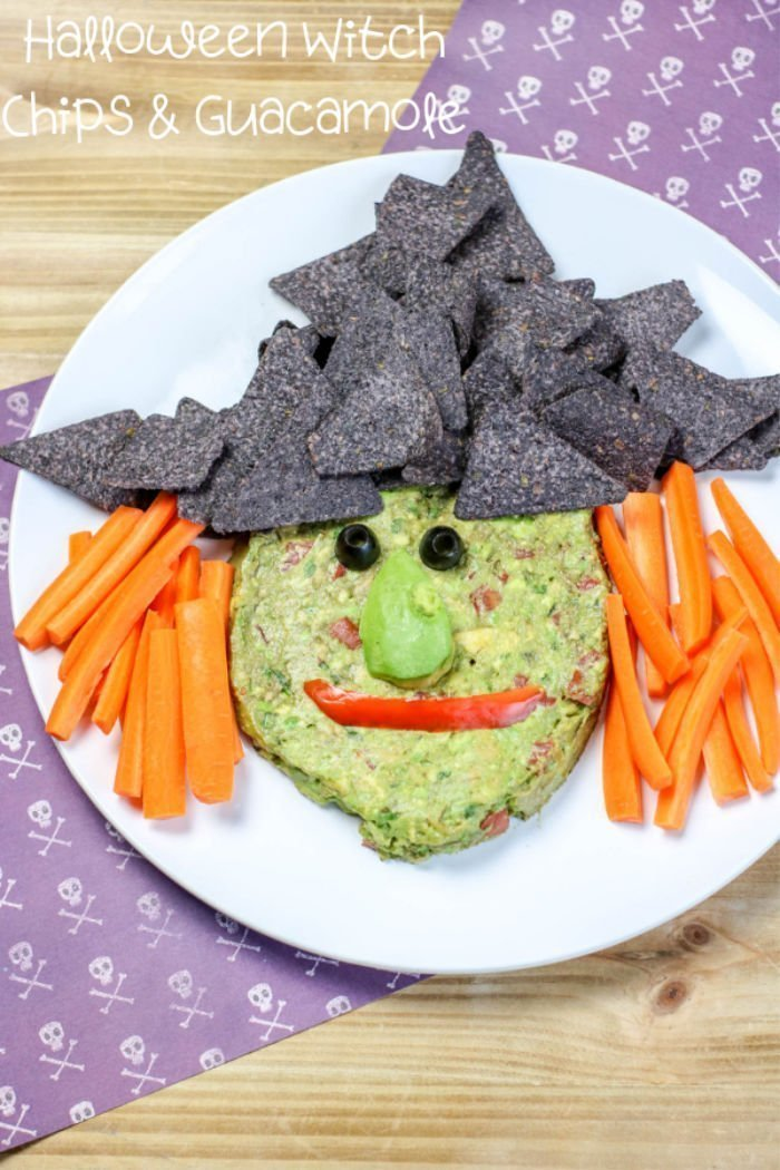 A guacamole dip made to look like a witches shape.
