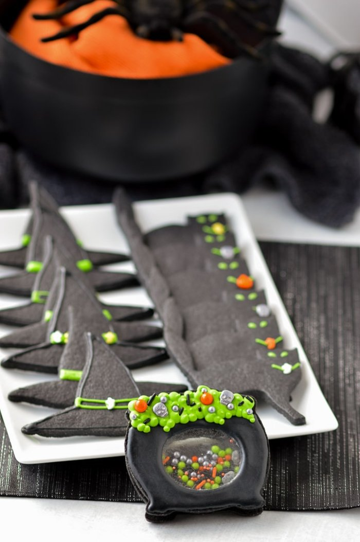 Halloween sugar cookie recipe that looks like witches hats and black cats.