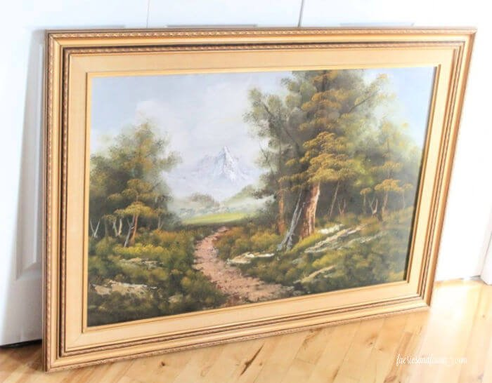 A large framed piece of artwork before being upcycled into a large chalkboard