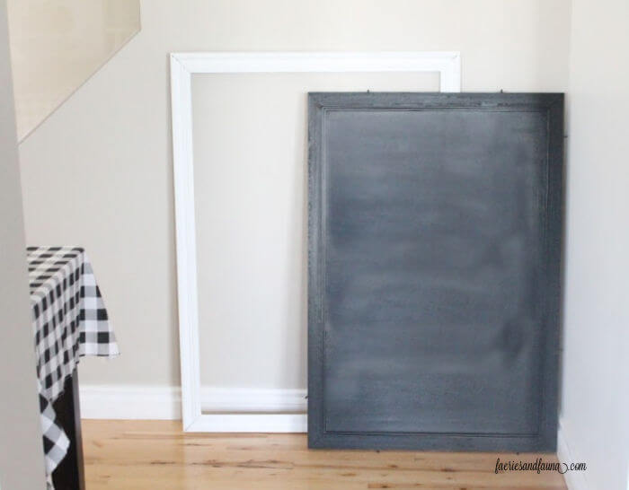 Painted chalkboard and white frame from an old piece of art.