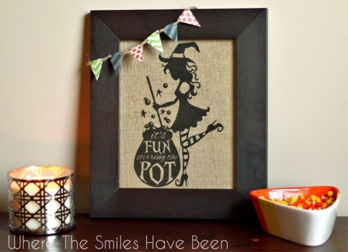 A Halloween witch craft, making a burlap sign for Halloween.