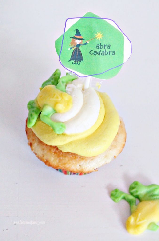 A Halloween cupcake with buttercream a toad and abracadabra free printable cupcake topper