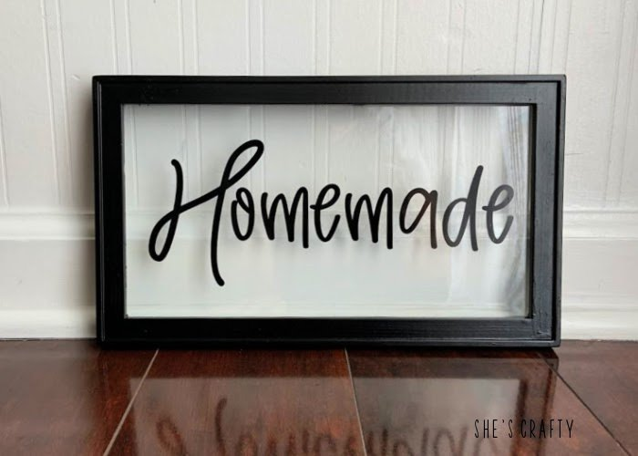An upcycled sign that says Farmhouse