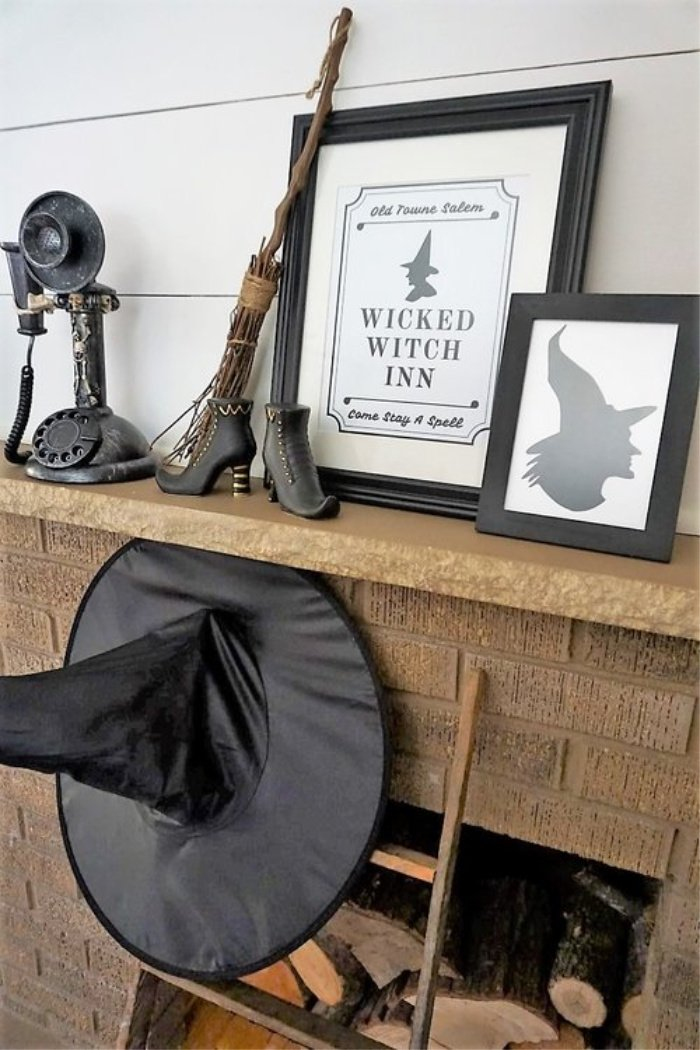 A halloween witch themed mantel. DIY Halloween decorations featuring a witch hat, and witch sayings