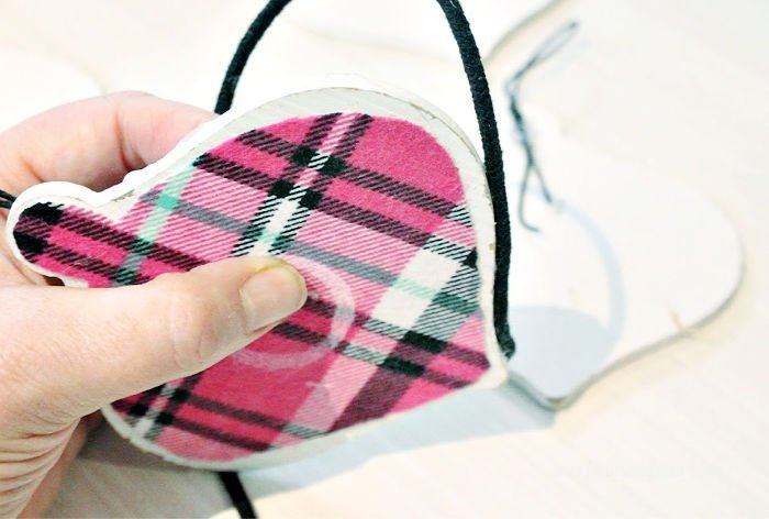A handmade Christmas ornament with flannel plaid.