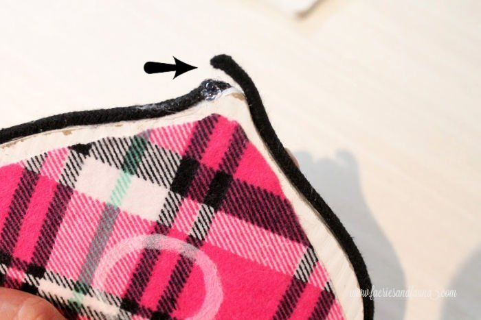 How to add trim to a handmade Christmas tree ornament craft. These DIY Christmas ornaments are made with pink plaid flannel and wood cutouts